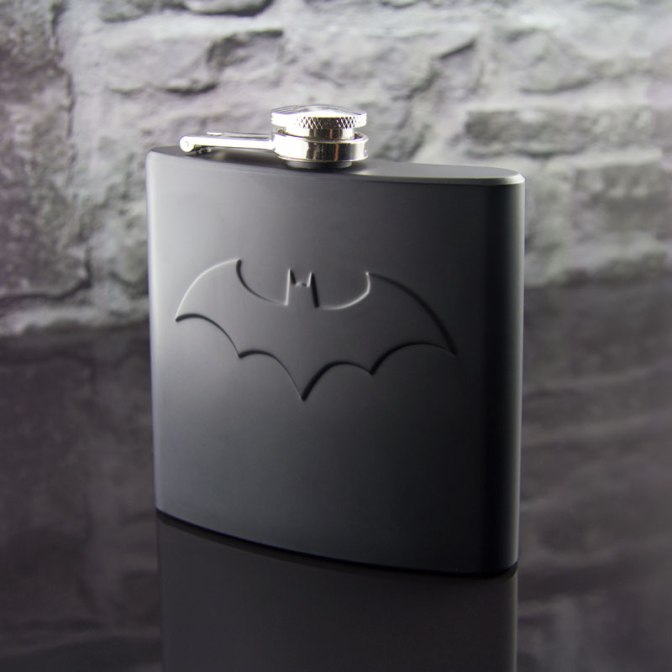 Never Leave the Cave Without It! The Paladone Batman Hip Flask